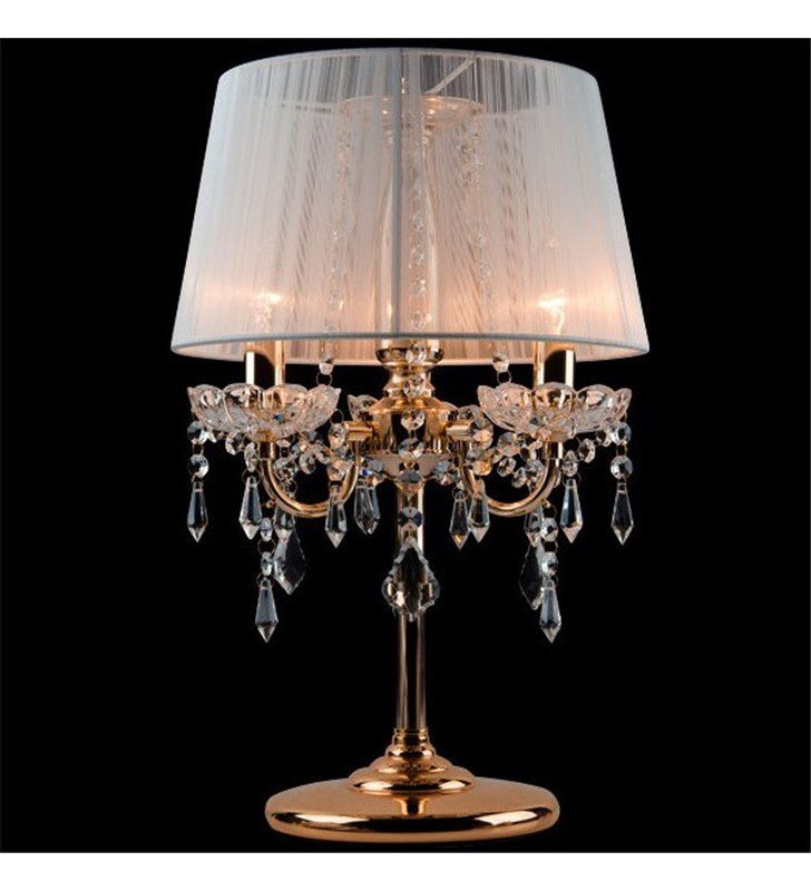 Stylowa złota lampa stołowa Izabel potrójna kryształowa z białym abażurem